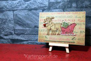 Weihnachtskarte mit Schlitten und dem letzten Geschenk